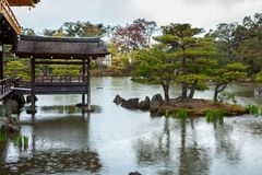 Free The Fishing Deck And Small Islets At The Rear Of The Golden Pavilion Or Rokuon-ji Or Kinkaku-ji. Rainy Day With Falling Drops On W Stock Photos - 103026153