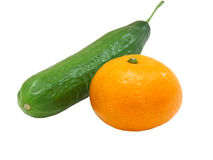 The Fresh Green Cucumber With A Tangerine Royalty Free Stock Photos