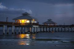 Free The Ft.Myers Pier At Night With A Warm, Yellow Light Reflecting In The Water. Stock Photos - 99817153