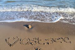 Free The German Word Ostsee Baltic Sea And A Heart Written Into The Sand Of The Beach Royalty Free Stock Images - 206845249