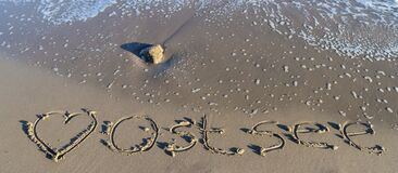 Free The German Word Ostsee Baltic Sea And A Heart Written Into The Sand Of The Beach Royalty Free Stock Photos - 206845258