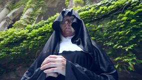 Free The Ghost Of A Nun Walks Through The Ruins Of An Old Monastery. 4 K. Slow-motion Shooting Stock Photos - 98109173