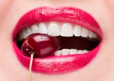 Free The Girl Bites A Ripe Cherry. Cherry In Mouth Close Up Royalty Free Stock Photography - 158657947