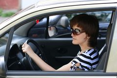 The Girl Drives The Automobile Stock Image