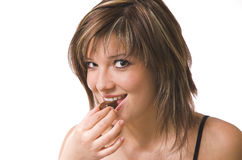 The Girl Eats A Sweet Royalty Free Stock Image
