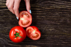 Free The Girl In The Hands Holding A Tomato Stock Photos - 73385573