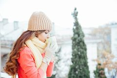The Girl In The Hat Froze And Drinking Hot Tea Stock Photo