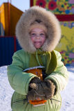 The Girl In Winter Clothes Stock Photo