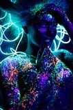 The Girl Is The Image Of The Devil, Contact Lenses And With Horns. Woman In UV Paint. Fluorescent Powder. Body Art Royalty Free Stock Photos