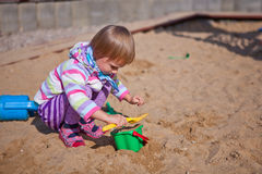 Free The Girl Playing To A Sandbox Stock Photography - 21999362