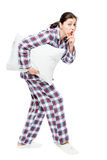 The Girl Quietly Goes To Sleep, Carries An Alarm Clock Royalty Free Stock Image