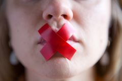The Girl�s Mouth Is Sealed With Tape. Royalty Free Stock Image