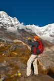 The Girl Takes Photo Of Mountains Stock Image