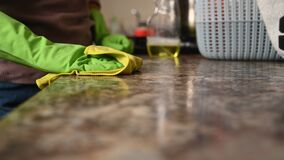 Free The Girl Washes The Countertop In The Kitchen Royalty Free Stock Photos - 199113288