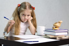 Free The Girl Writes On A Piece Of Paper Sitting At The Table In The Image Of The Writer Royalty Free Stock Images - 30207039