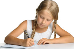 The Girl Writes To Writing-books Royalty Free Stock Photo