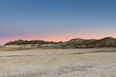 Free The Glowing Sky Of Sunset Over The Desert Landscape Of The Bisti Badlands Of New Mexico Royalty Free Stock Photo - 139769605