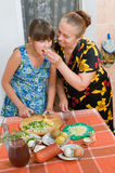 The Grandmother Treats The Grand Daughter. Royalty Free Stock Image