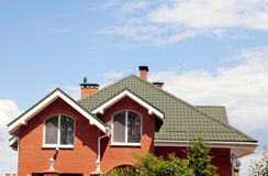 Free The Green Roof Of The Beautiful House With Nice Window And Blue Royalty Free Stock Photos - 68511678