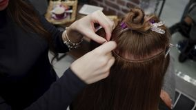Free The Hairdresser Sews Artificial Hair To The Real Thing. The Process Of Hair Extension. 4K Royalty Free Stock Photos - 141278498