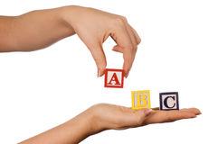 The Hand Holds A Cube With Letters Royalty Free Stock Photography