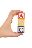 The Hand Holds A Cube With Letters Royalty Free Stock Photo