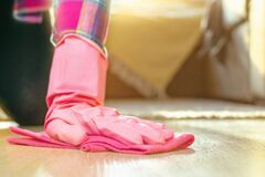 Free The Hand Of A Young Woman In A Pink Rubber Glove Holds A Soft Rag Washes The Floor. Home Cleaning, Washing Floors Royalty Free Stock Images - 195628859