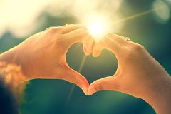 Free The Hands Of Women And Men Are The Heart Shape With The Sun Light Passing Through The Hands Stock Image - 163491841