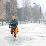 The Happy Woman Is Riding A Bicycle In The Winter City.