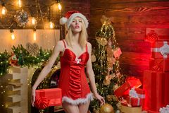 The Holiday Wish List. Beautiful And A Sexy Blonde Woman In Red Lingerie Showing Christmas Balls. Celebrating Noel Party Royalty Free Stock Photo