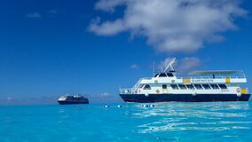Free The Holland America Line Zuiderdam Cruise Ship Anchored Off The Private Island Of Half Moon Cay In The Bahamas On A Sunny Day With Royalty Free Stock Photos - 202421058