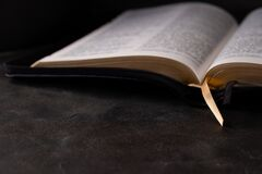 Free The Holy Bible On Dark Background. Christianity Concept Royalty Free Stock Image - 176241446