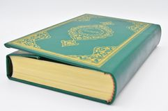 The Holy Book Of Muslims, The Qur`an Book Green. Stock Photos