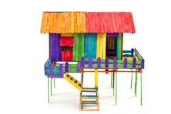 Free The House Is Made Of Toys From Colorful Popsicle Sticks On A White Background. Stock Photo - 162254940