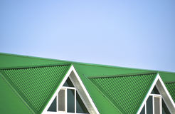 Free The House With Plastic Windows And A Green Roof Of Corrugated Sheet Stock Photography - 77583182
