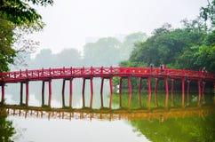 The Huc Bridge Or Sun Shine Bridge At Hoan Kiem Lake, It`s A Red Wooden Arch Bridge Stock Photography