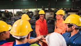Free The Industrial Worker Team In A Large Industrial Factory With Many Equipment Royalty Free Stock Photos - 186569718