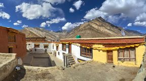 Free The Inner Courtyard Of The Buddhist Monastery Of Rangdum, The Yellow And White Prayer Buildings Of The Gong, In The Background Hig Royalty Free Stock Photo - 103471145