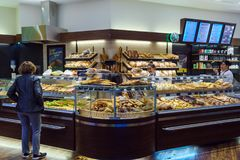The Interior Of The Store With A Large Selection Of Bread, Rolls Stock Photo