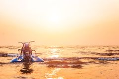 Free The Jet Ski Is Over The Water Sea Between Sunset Royalty Free Stock Photos - 109879988