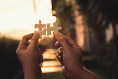 Free The Jigsaws Is Connecting By People In The Shine Evening Stock Photography - 134090982