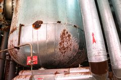 Free The Large Tank Heat Exchanger In Insulation Insulated By Rust Corrosion With Holes Is Old At An Industrial Chemical Oil Refinery Royalty Free Stock Photos - 148494198