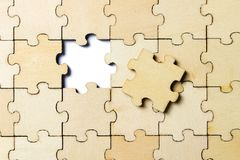Free The Last Piece Of A Jigsaw Wooden Puzzle Stock Photography - 110652862