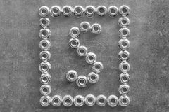 Free The Letter S Of The English Or Latin Alphabet Lined With Metal Nuts. Royalty Free Stock Photography - 104501227