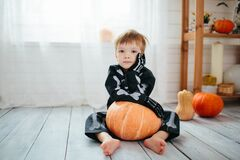 Free The Little Boy In A Skeleton Costume Is Ready To Celebrate Halloween. Boy In A Halloween Dress-up Room Royalty Free Stock Photography - 199332747