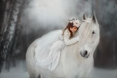 Free The Little Princess With An Unicorn In The Forest. Stock Photo - 138388080