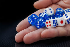 Free The Male Hand Throwing Dices On Dark Background Royalty Free Stock Photo - 85501085
