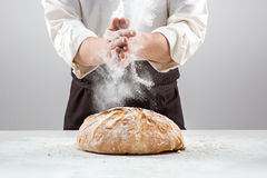 Free The Male Hands In Flour And Rustic Organic Loaf Of Bread Royalty Free Stock Images - 83871479