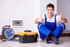The Man Doing Electrical Repairs At Home Stock Photos