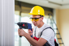 Free The Man Drilling The Wall With Drill Perforator Royalty Free Stock Photo - 81105865